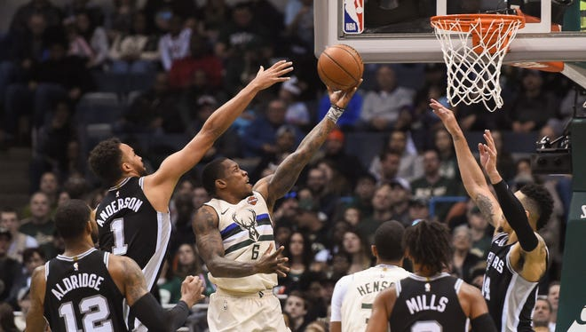Bucks guard Eric Bledsoe takes a shot against Spurs forward Kyle Anderson.