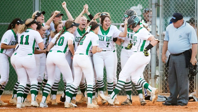 Fort Myers High School softball players celebrate Vivian Pon's home run Wednesday against Palmetto Ridge during the Region 7A-3 quarterfinal at Fort Myers High School.