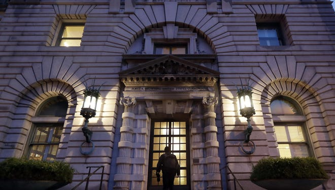 In this Feb. 9, 2017, file photo, a man walks up the steps of the 9th U.S. Circuit Court of Appeals building in San Francisco.