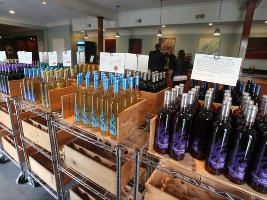 Wine bottles line the tasting room at the Stoutridge