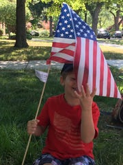 Theo Ryan, 3, of Grosse Pointe Park awaits the Fourth of July parade in Huntington Woods on July 4, 2016.