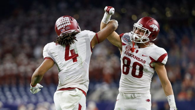Dec 29, 2014; Houston, TX, USA; Arkansas Razorbacks wide receiver Keon Hatcher (4) celebrates his touchdown catch with wide receiver Drew Morgan (80) during the first half in the 2014 Texas Bowl at NRG Stadium. Mandatory Credit: Kevin Jairaj-USA TODAY Sports