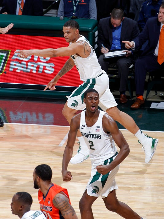 Michigan State's Miles Bridges, top, and Jaren Jackson Jr. (2) celebrate Bridges' 3-pointer against Illinois during the first half of an NCAA college basketball game Tuesday, Feb. 20, 2018, in East Lansing, Mich. (AP Photo/Al Goldis)