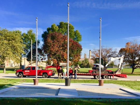 Flag poles at Red Arrow Park in Manitowoc. Pictured,