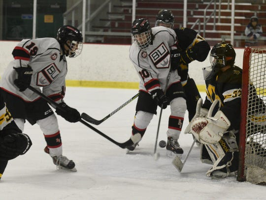 Birmingham Unified's Charlie Michaud (19) and Lucas Bayagich get the puck past AO goale for the first of 10 goals on the night.