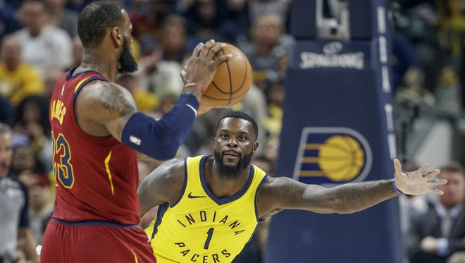 Indiana Pacers guard Lance Stephenson (1) defends against Cleveland Cavaliers forward LeBron James (23) during the first half of Game 4 at Bankers Life Fieldhouse on Sunday, April 22, 2018.
