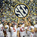 Alabama players  celebrates after their SEC title game win.