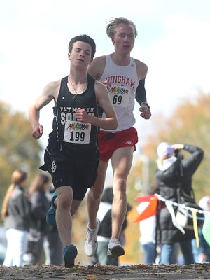Plymouth South's Pat Clarke runs down the hill while Hingham's Evan Lamlein follows right behind him during the Patriot League Championship meet last year.