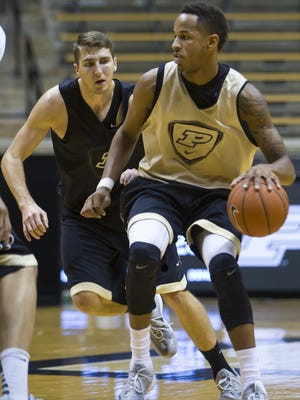 Neal Beshears guards Purdue freshman Vince Edwards during practice Oct. 18, 2014.