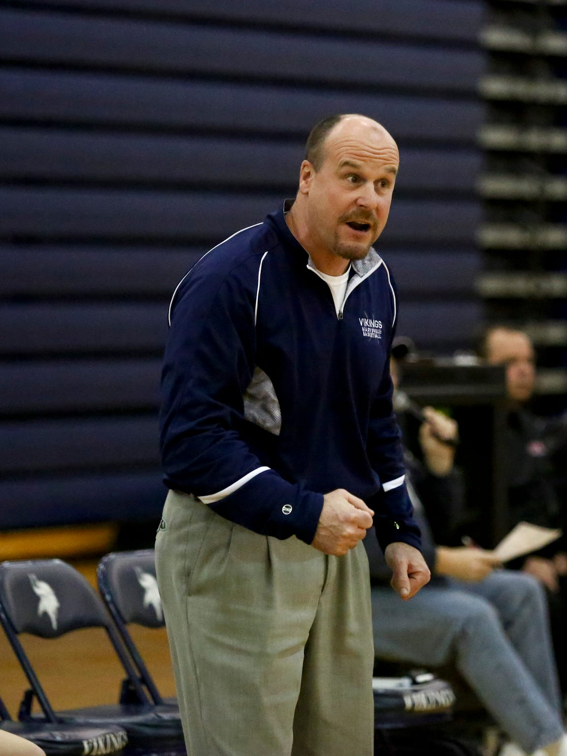Marysville assistant coach Tom Valko reacts on the