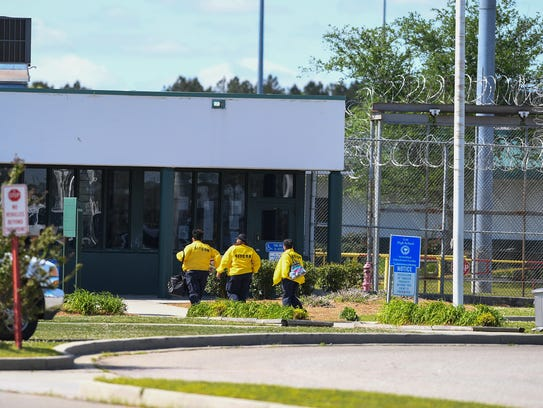 Employees arrive at Lee Correctional Institution on