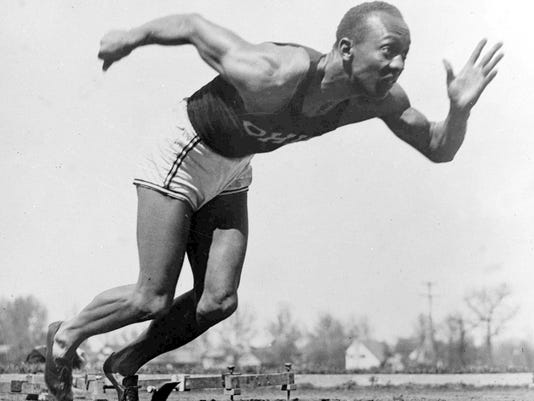File - In this Aug. 5, 1936 file photo, American athlete Jesse Owens practices in the Olympic Village in Berlin. Shortly after Jesse Owens returned home from his snubbing by Adolph Hitler at the 1936 Olympics, he and America's 17 other black Olympians found a less-than-welcoming reception from their own government, as well. On Thursday, Sept. 29, 2016 relatives of those 1936 African-American Olympians will be welcomed to the White House and will get to shake the President's hand, an honor Owens and the others didn't receive after they returned home from Berlin 80 years ago. (AP Photo/File)