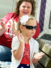 Allison Rosenau, 4, of Shiloh, claps along with the music with her aunt Janell Tomes and other family members who came to watch the Dover Area High School jazz band perform during Box Lunch Revue at Cherry Lane Tuesday, May 16, 2017. The group voted earlier in the day prompting Allison's red, white and blue attire. Box Lunch Revue takes place Tuesdays and Thursdays from 11:30 a.m. to 1:30 p.m. May through August. Bill Kalina photo