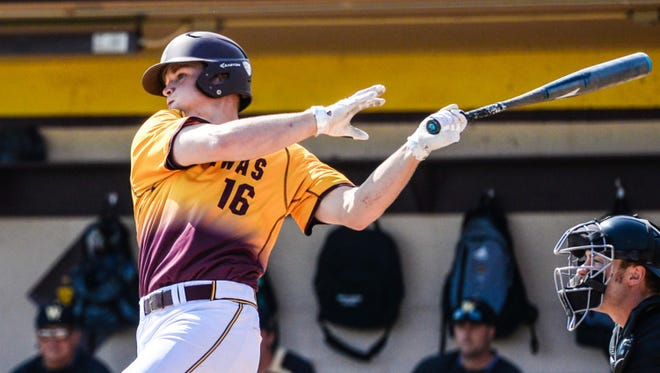 Following through after hammering another pitch for Central Michigan University is Daniel Jipping, a Canton native who was drafted Wednesday by the Colorado Rockies.