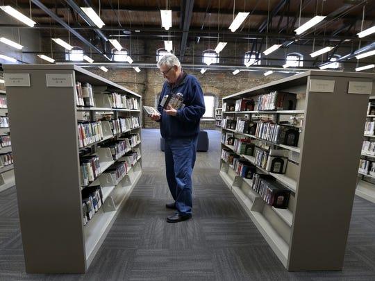 Lance Goetzman chooses audio books at the Kaukauna