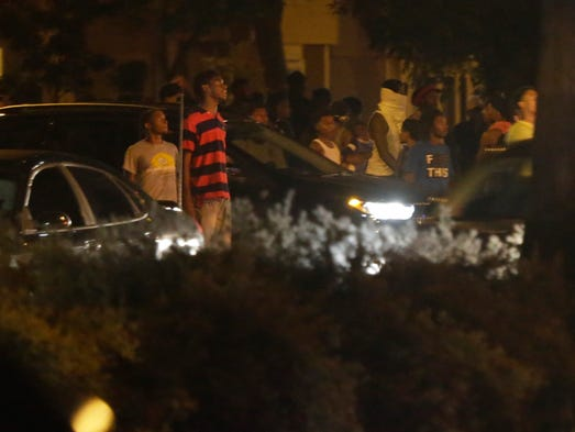 A crowd gathers near N. Sherman Blvd. and W. Auer Ave.