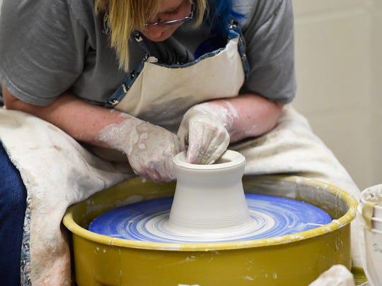 An Ankeny Art Center artist demonstrates pottery.