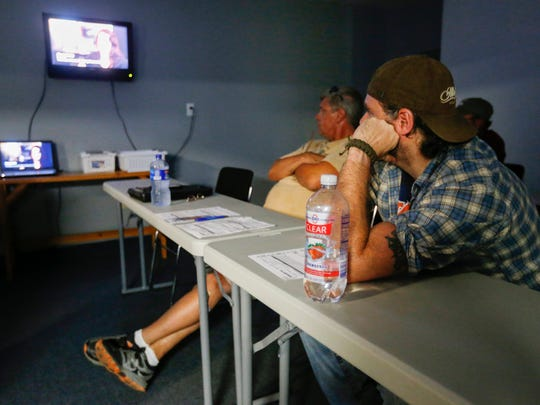 Jeremy Chaney, right, along with other students at Specialized Driver Training, watch a video on sex trafficking.