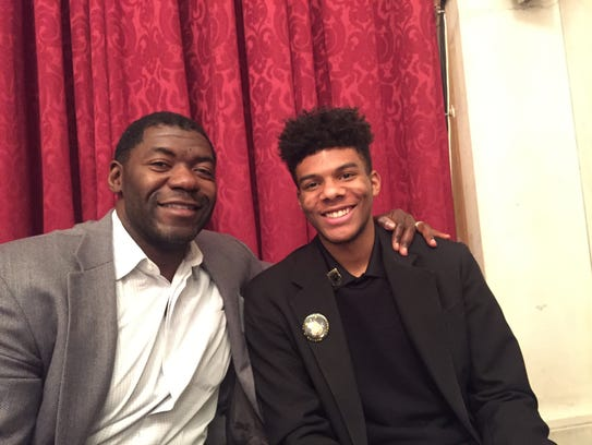 Former NFL player Roman Oben, left, with Joshua Mitchell