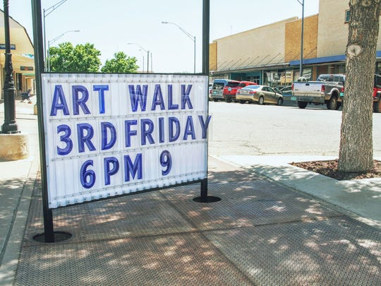 A sign displaying The Art Walk information on the corner of New York Ave. and 9th St.