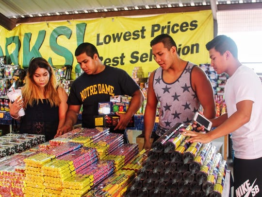 In this 2016 file photo from left to right: Cassandra Dixon, Jessi Trujillo, Santiago Trujillo and Andy Trujillo shop for fireworks at Amy's Fireworks on U.S. Highway 70 in Alamogordo.