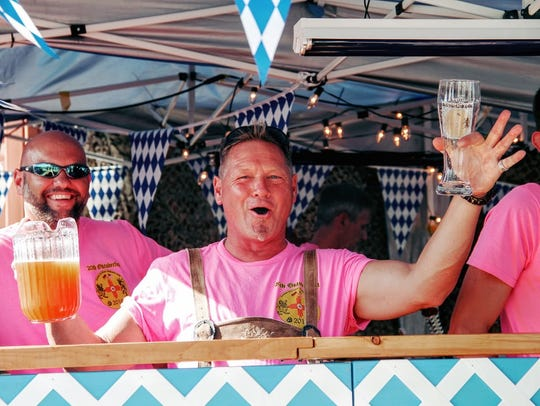 In this 2016 file photo, a bartender at the 20th Oktoberfest