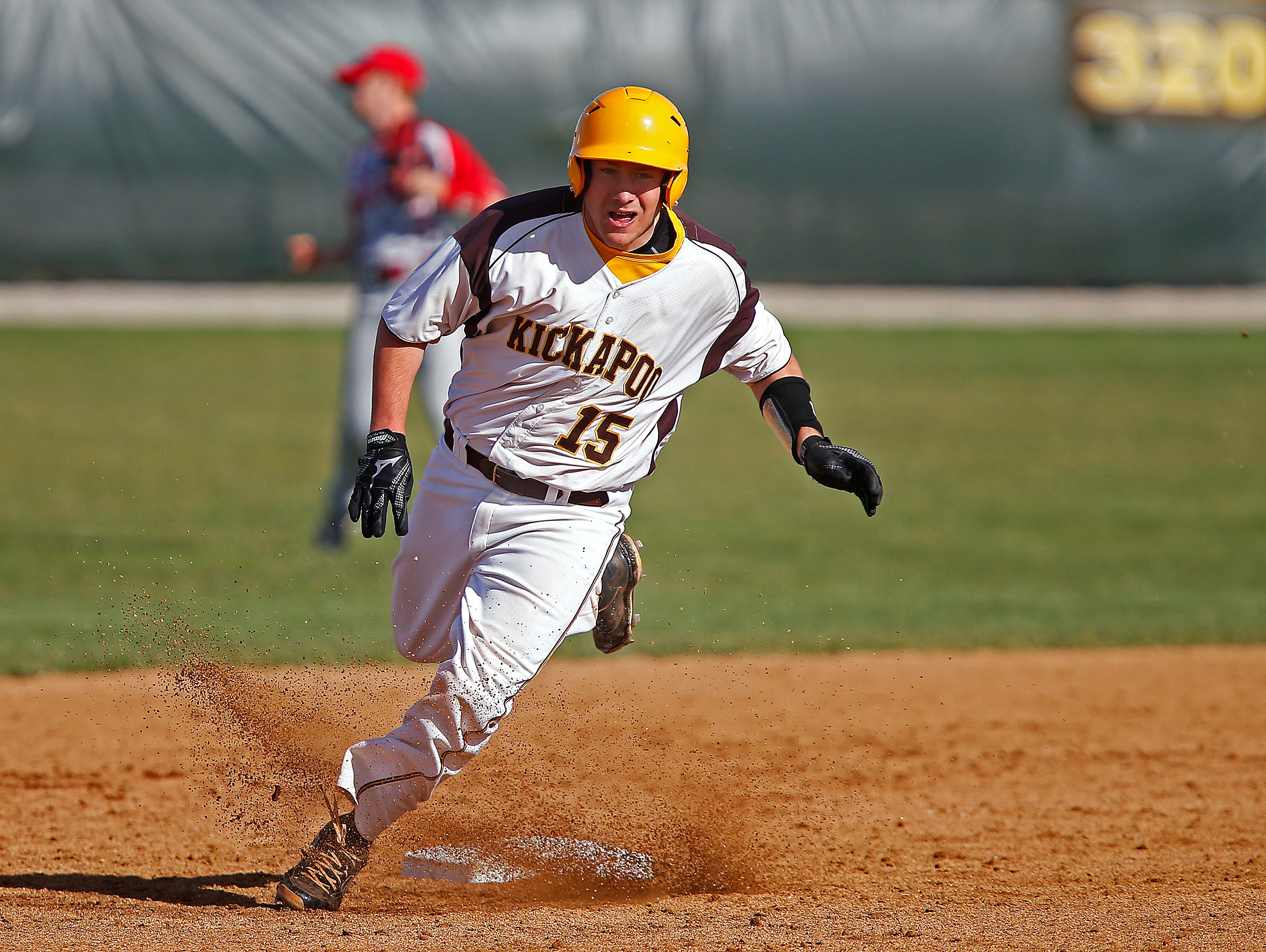 Kickapoo High School catcher Westin Gann (15) attempts to round out second base during second inning action of the high school baseball game between Kickapoo and Ozark at Kickapoo High School in Springfield, Mo. on March 29, 2016.