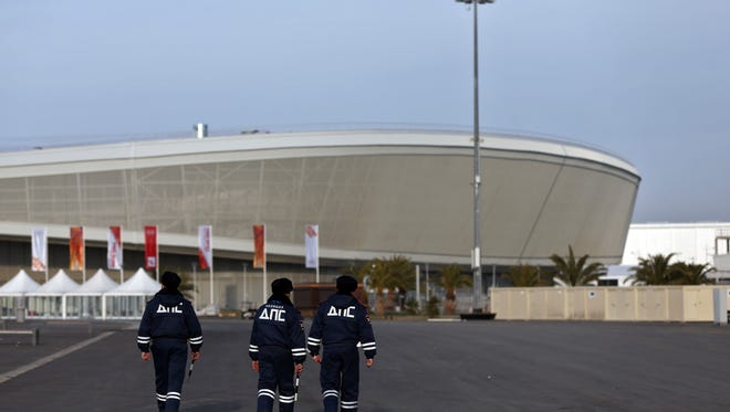 Security personnel walk in the Olympic Park in the Coastal Cluster on Jan. 9 in Adler, Russia.