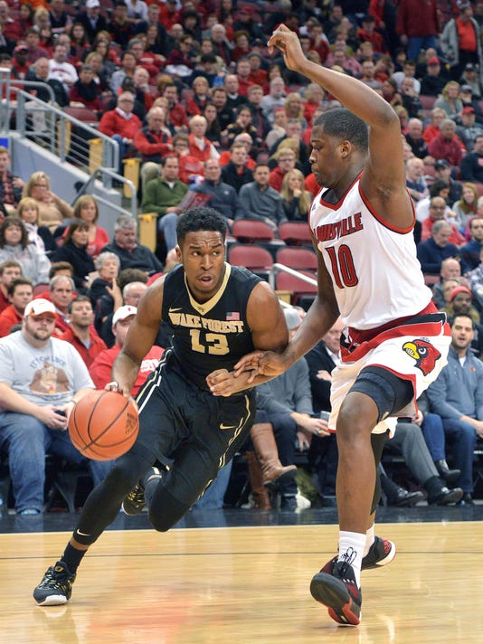 Wake Forest's Bryant Crawford (13) attempts to drive past the defense of Louisville's Jaylen Johnson (10) during the first half of an NCAA college basketball game, Sunday, Jan. 3, 2016, in Louisville, Ky. (AP Photo/Timothy D. Easley)