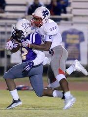Benton's Jermaine Newton Jr. tries to run past North Desoto's Caleb Brown during their game Friday evening at Benton High School.
