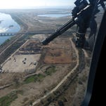 Mexican federal police fly over the Balsas River near the Pacific port of Lazaro Cardenas, Mexico.