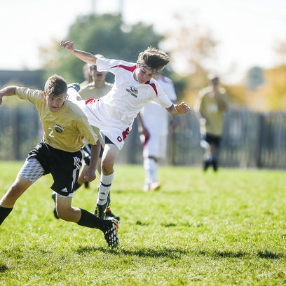 Liberty Common's Paul Boehner battles for a ball in