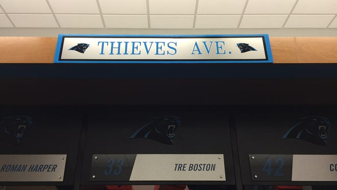 The Thieves Ave. sign that rests above the lockers of Panthers defensive backs.