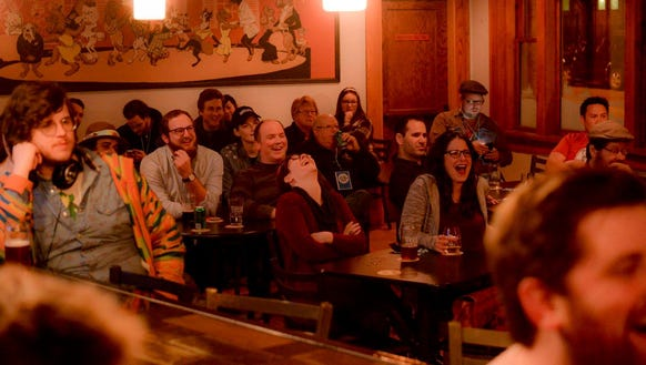 A crowd at Fernson on 8th breaks out into laughter