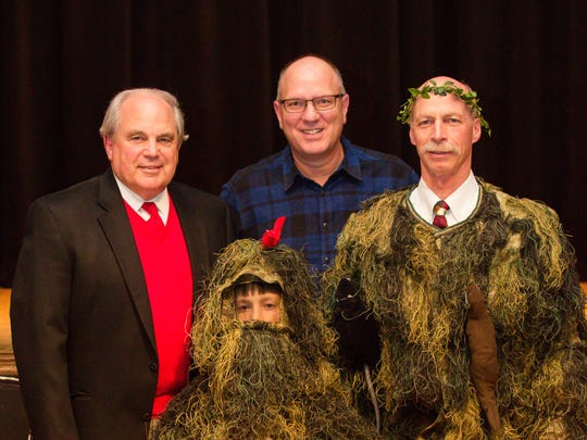 Oak Ridge Mayor Warren Gooch, Ted Sherry and Chris Clark, with his son Pete, both dressed as National Park bushes, at the Children's Museum of Oak Ridge Gala.