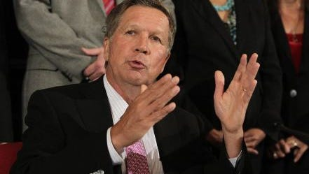 """Ohio Gov. John Kasich talks about Ohio's 2016-2017 operating budget before signing it Tuesday, June 30, 2015, in Columbus, Ohio. Kasich said the $71.2 billion, 2-year state budget he signed helps people without getting """"loose"""" with the spending. (AP Photo/Jay LaPrete)"""