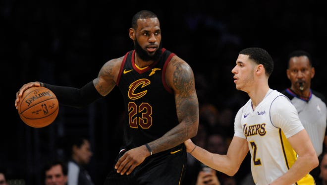 Cleveland Cavaliers forward LeBron James (23) moves the ball against Los Angeles Lakers guard Lonzo Ball (2) during the second half at Staples Center.