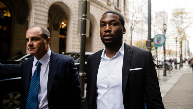 Rapper Meek Mill, right, accompanied by his attorney Brian Mcmonagle arrives at the criminal justice center in Philadelphia on Nov. 6, 2017.