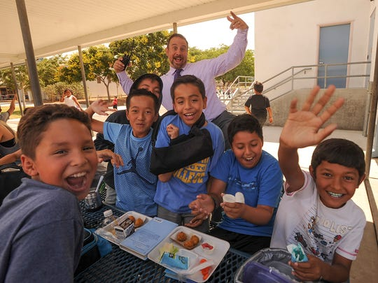 Flory Academy Principal Scott Mastroianni photo bombs fourth-graders as they have their picture taken during lunchtime at the school recently.