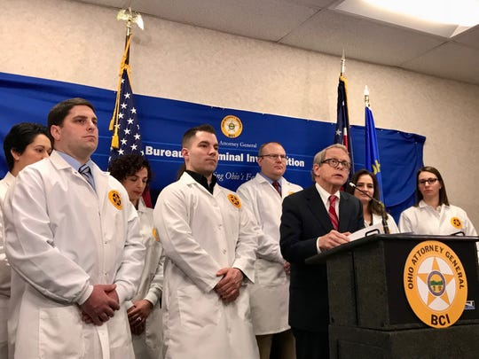 Attorney General Mike DeWine at a February news conference at the Bureau of Criminal Investigation crime lab in Richfield announcing that testing was complete on nearly 14,000 previously untested rape kits submitted by close to 300 Ohio law enforcement agencies. More than 5,000 of the kits resulted in hits. Yet oly a handful of the hits resulted in charges being brought, a Plain Dealer investigation shows.