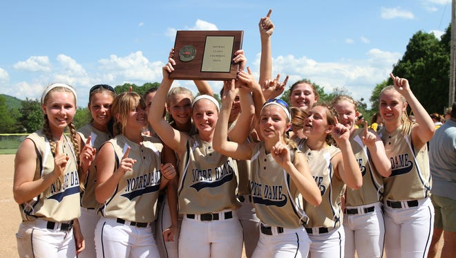 Members of the Notre Dame softball team hold up the Section 4 Class C championship plaque they won after defeating Tioga in the title game at the BAGSAI Complex on May 28.