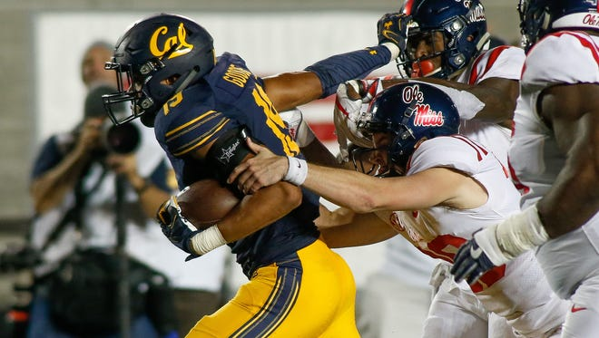 Golden Bears linebacker Cameron Goode (19) breaks tackles after intercepting the ball during the fourth quarter at Memorial Stadium.