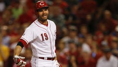 Reds first baseman Joey Votto reacts to a pitch Tuesday
