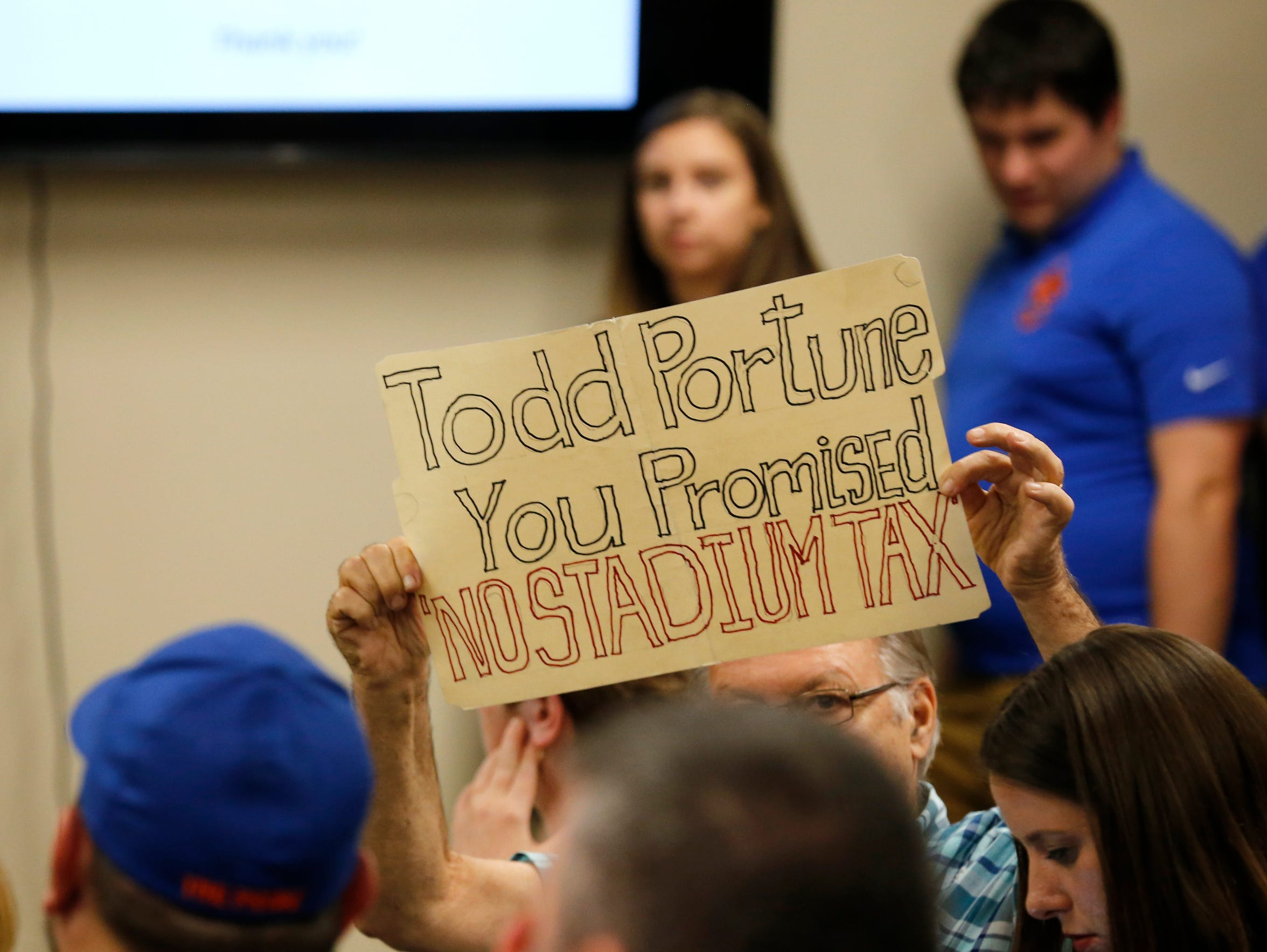 Charles Wolff, Green Township, holds up a sign as FC
