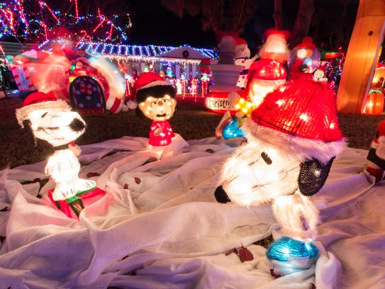 Snoopy characters on display at 3930 Calle De Las Margaritas on Wednesday, Dec. 6.
