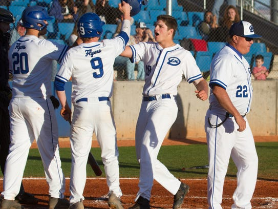 Dixie's Tyson Fisher (second from right) celebrates