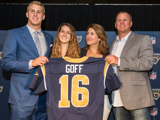 California's Jared Goff, left, poses for photos with his family after being selected by the Los Angeles Rams as the first pick in the first round of the NFL football draft, in Los Angeles Friday, April 29, 2016. From left to right are: Jared with sister, Lauren Goff, and parents, Nancy Goff and Jerry Goff. (AP Photo/Damian Dovarganes)
