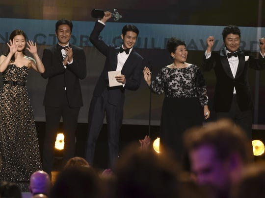 """Park So-dam, from left, Lee Sun Gyun, Choi Woo-shik, Lee Jeong-eun and Kang-Ho Song accept the award for outstanding performance by a cast in a motion picture for """"Parasite"""" at the 26th annual Screen Actors Guild Awards Sunday."""