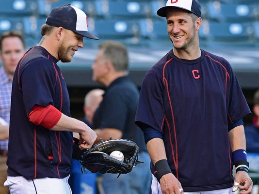 Cleveland Indians' Yan Gomes, right, laughs with Roberto Perez during an infield team-workout, Tuesday Oct. 4, 2016, in Cleveland. The Indians start the American League Divisional Series against the Boston Red Sox on Thursday in Cleveland. (AP Photo/David Dermer)