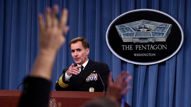 In this 2014 file photo, Pentagon press secretary Navy Rear Adm. John Kirby calls on a reporter during a briefing at the Pentagon.